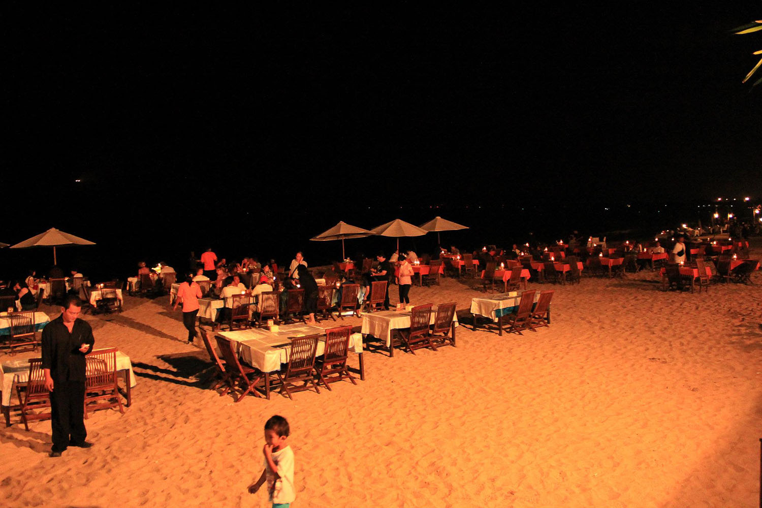 tables set up at the beach at Jimbaran, Bali