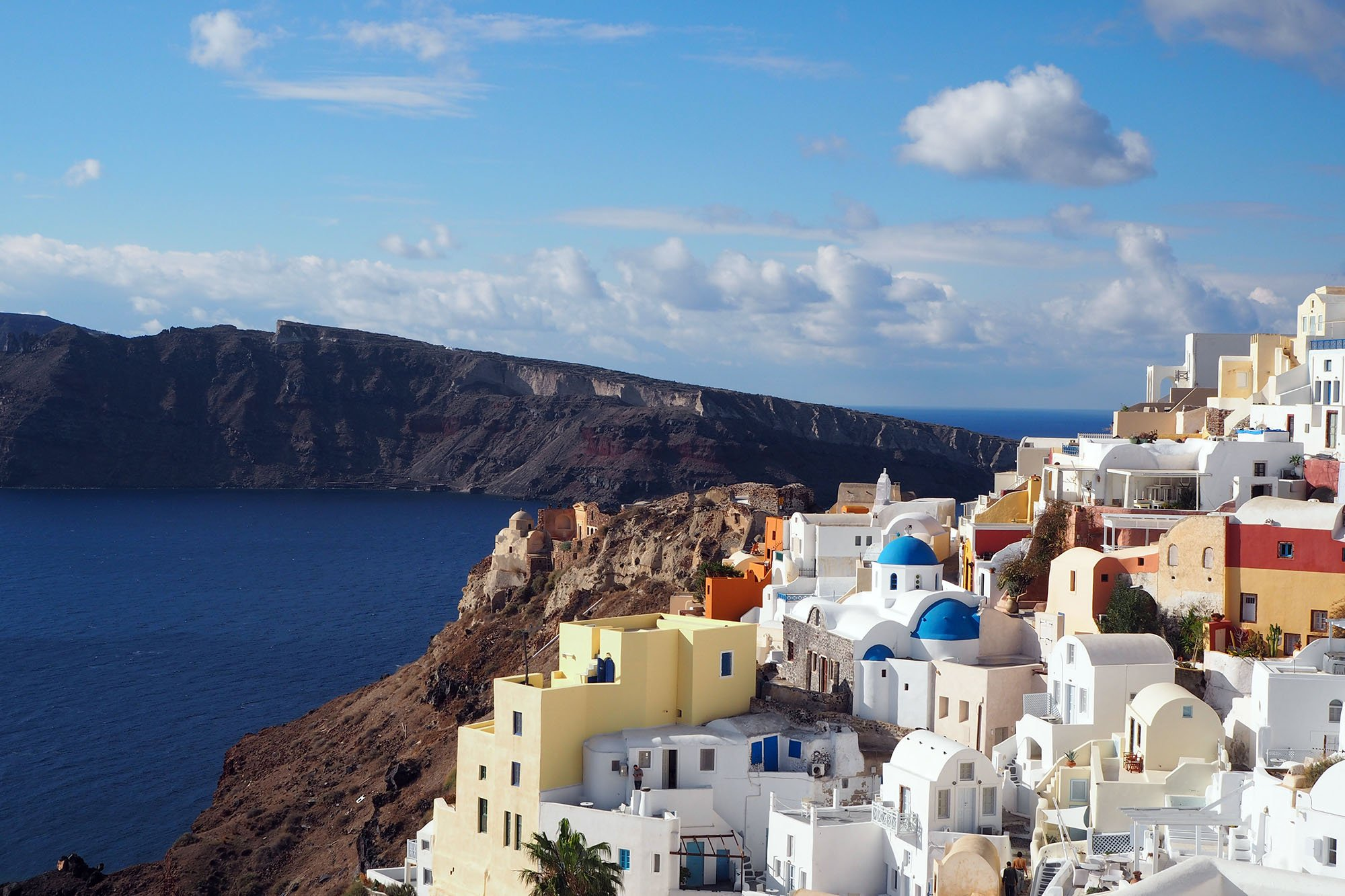 Oia for the houses on the cliff
