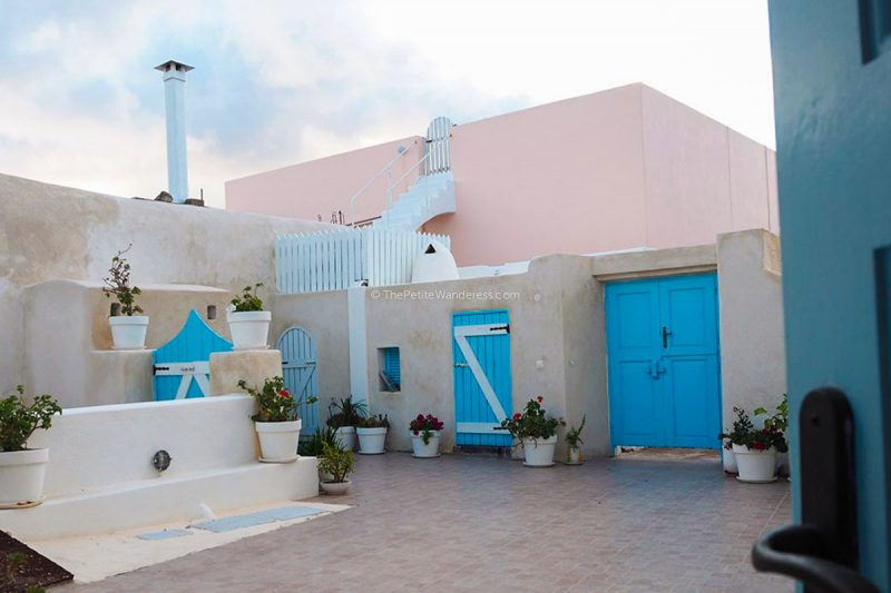 blue doors | Review: Dream Island Hotel, Fira, Santorini • The Petite Wanderess