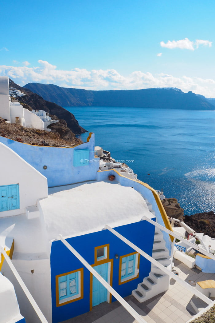 blue and white building in Oia | Santorini in shades of blue & white • The Petite Wanderess