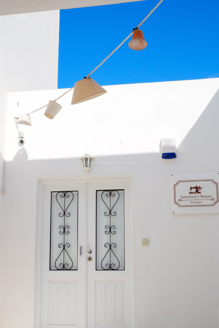 shop in Oia | Santorini in shades of blue & white • The Petite Wanderess