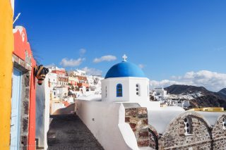 blue domed and white church in Santorini | Santorini in shades of blue & white • The Petite Wanderess