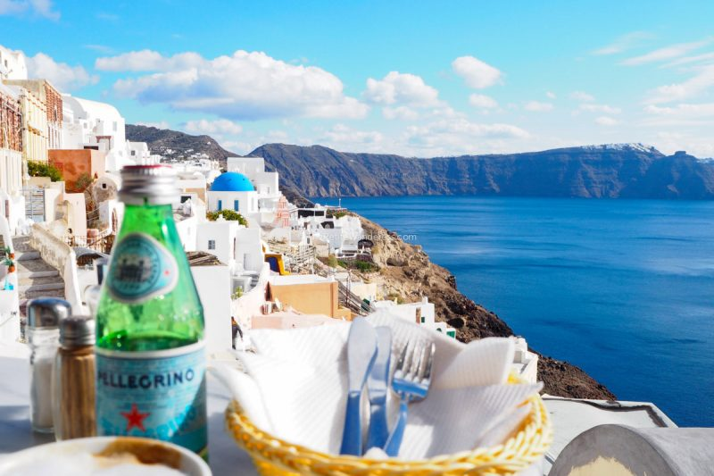 lunch view at Oia | Santorini in shades of blue & white • The Petite Wanderess