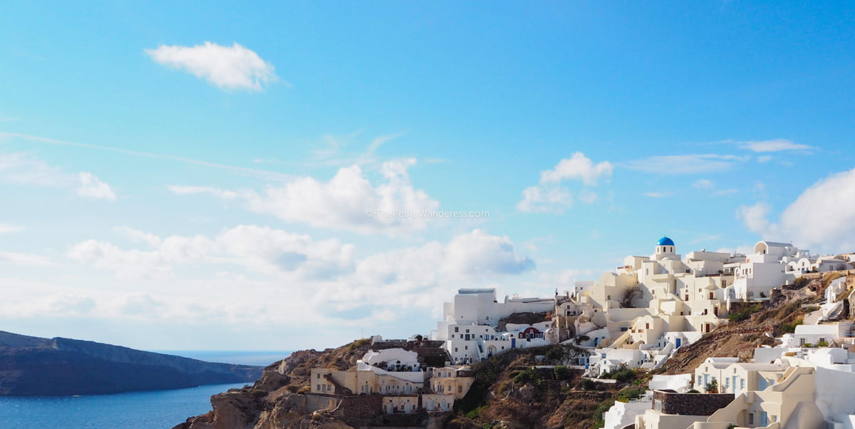 caldera view at Oia | Santorini in shades of blue & white • The Petite Wanderess