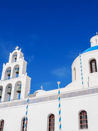 church at Oia | Santorini in shades of blue & white • The Petite Wanderess