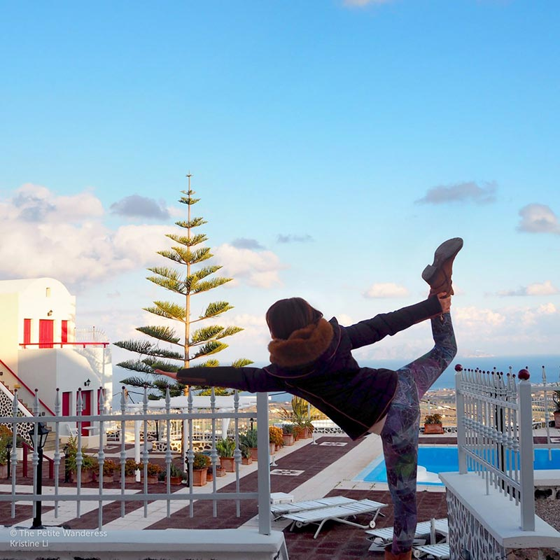 taking a yoga selfie in Santorini | What You Got Wrong About Your Weird Solo-Travelling Friend • The Petite Wanderess