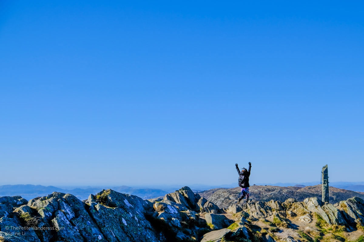 trying to jump | Hiking Mt Ulriken in Bergen • The Petite Wanderess