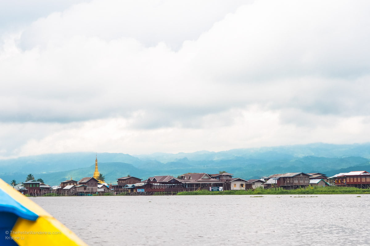 temple and houses along Inle Lake, Myanmar • The Petite Wanderess