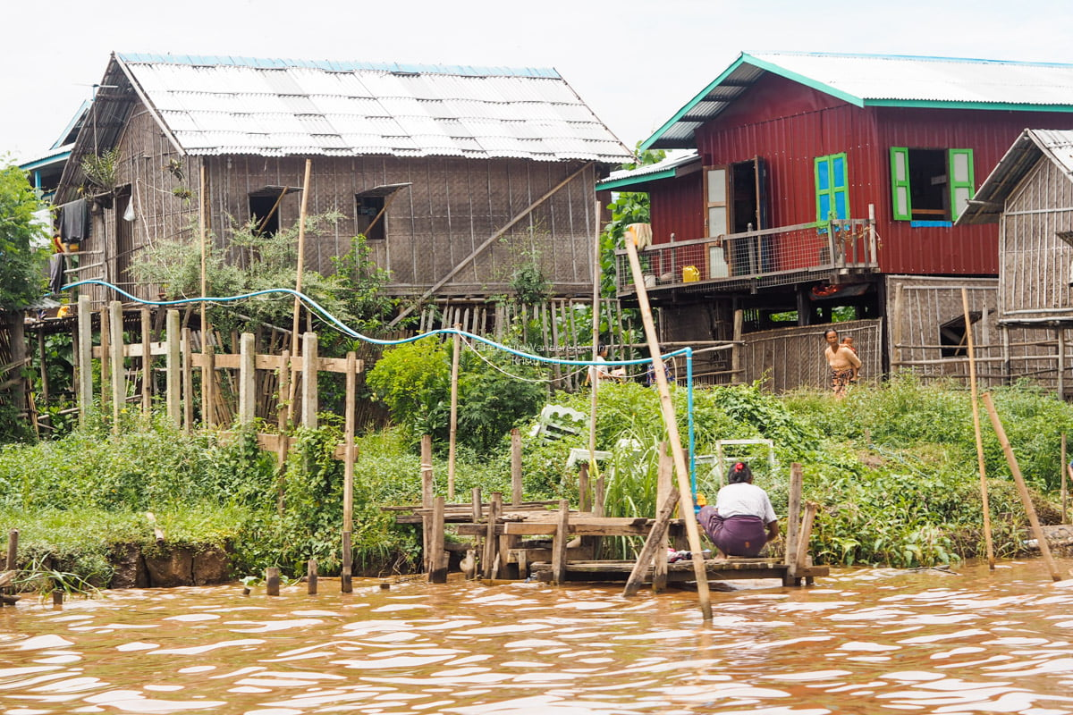 woman doing laundry at Inle Lake, Myanmar • The Petite Wanderess