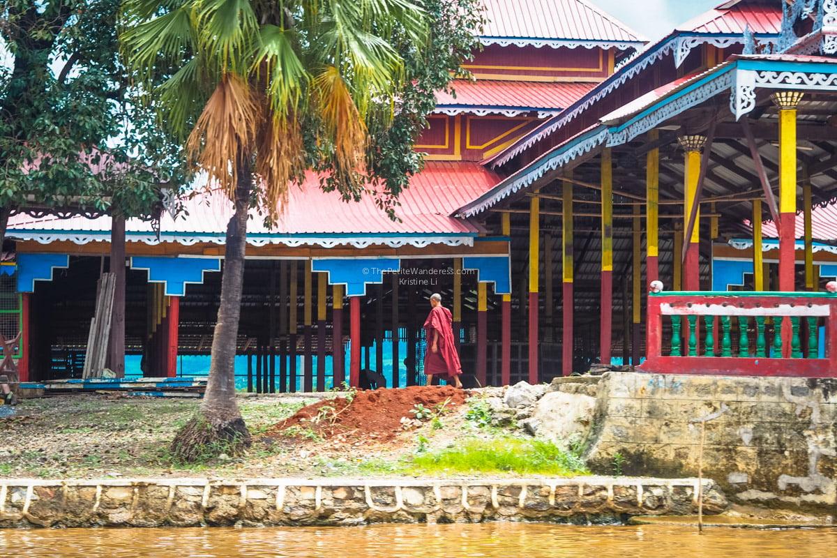monk and monastery at Inle Lake, Myanmar • The Petite Wanderess