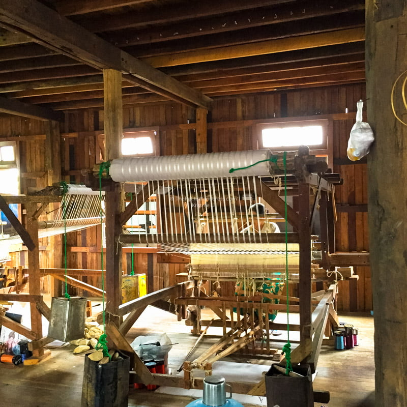 hand-operated traditional weaving loom at Inle Lake, Myanmar • The Petite Wanderess