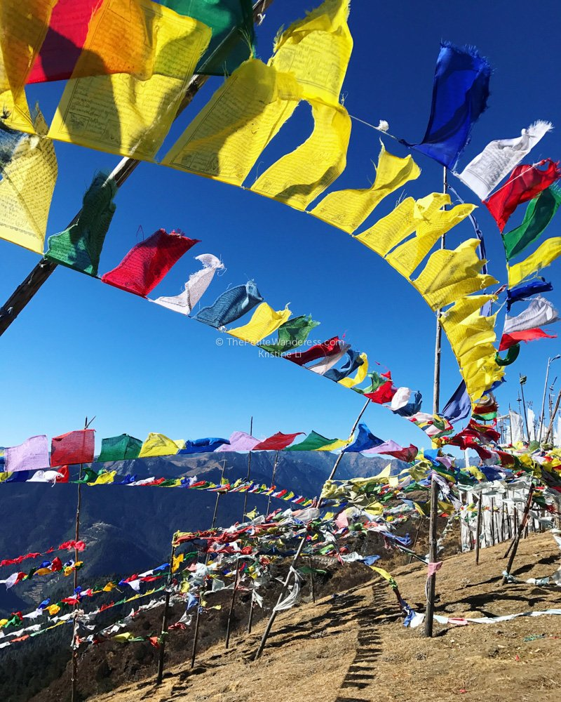 prayer flags at Chele La Pass | All Your First-World Questions about a Bhutan Trip, Answered! • The Petite Wanderess