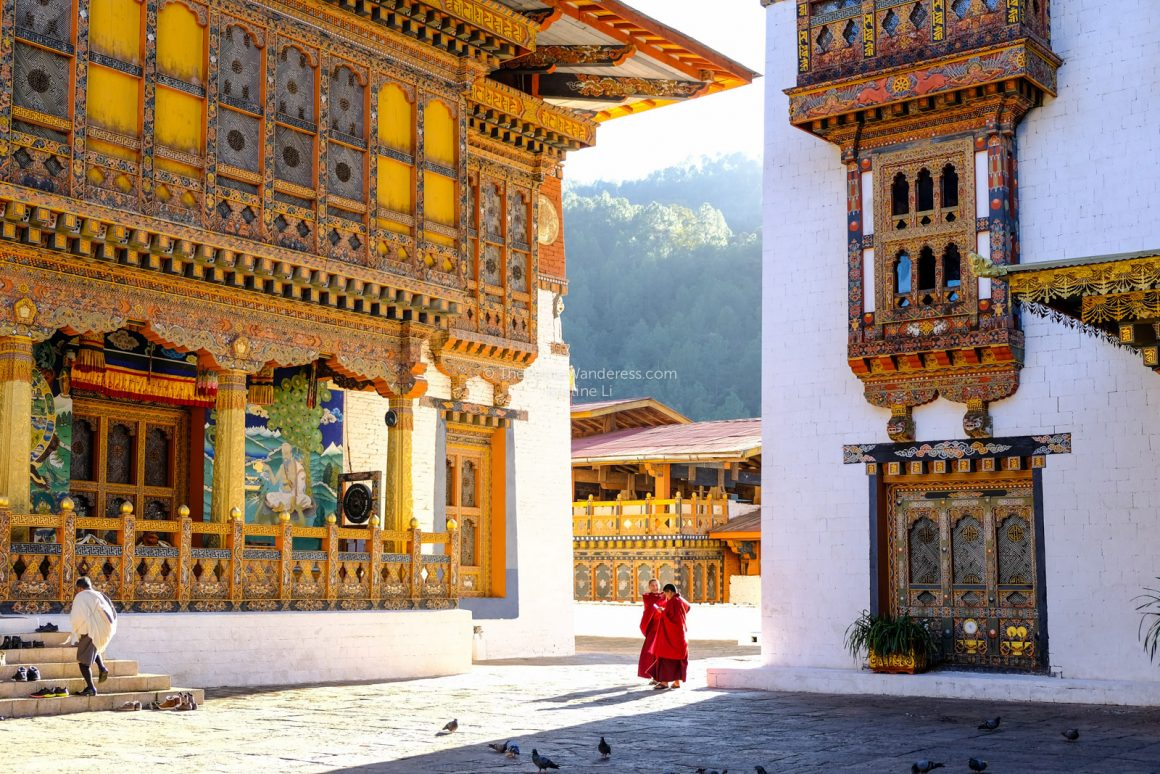 monks at Punakha Dzong | All Your First-World Questions about a Bhutan Trip, Answered! • The Petite Wanderess