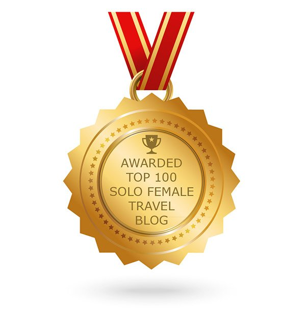 Badge: Top 100 Solo Female Travel Blog • The Petite Wanderess