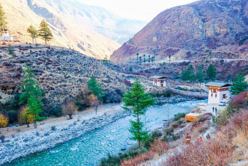 river and suspension bridge at Thimphu, Bhutan • The Petite Wanderess