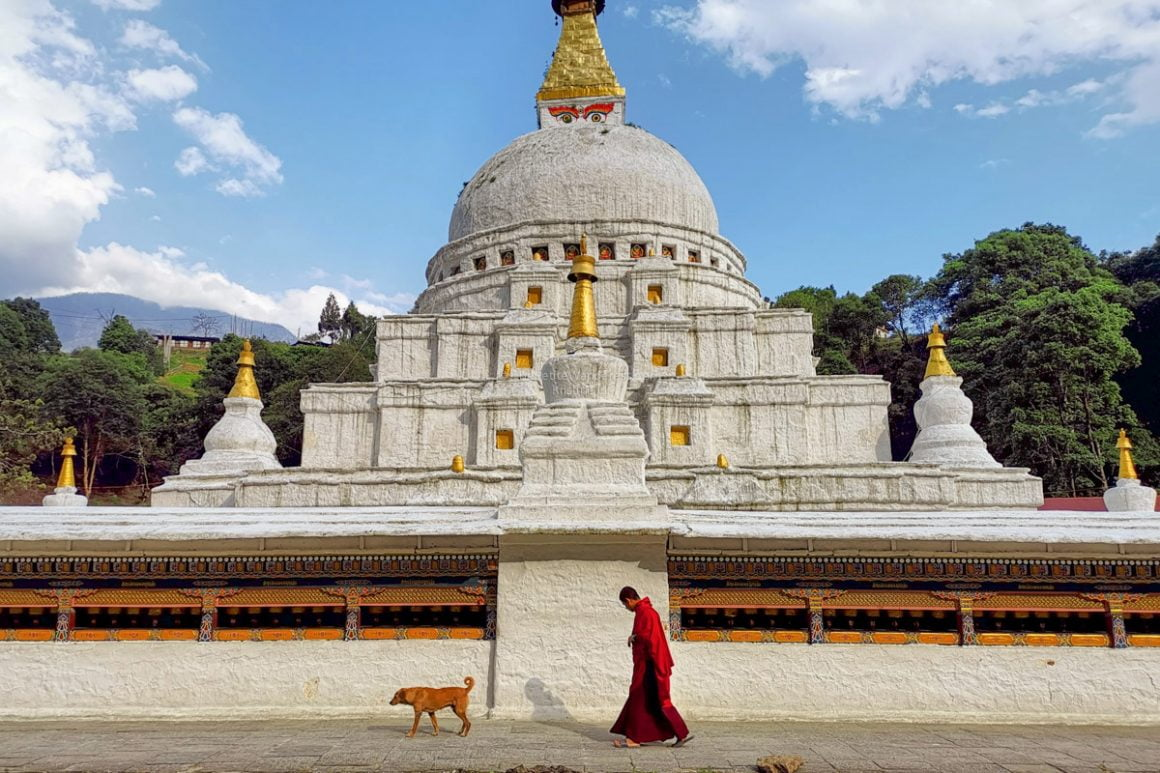 monk at Gom Kora, Eastern Bhutan | Lessons on Love & Wisdom Learned from Bhutan's People and Culture • The Petite Wanderess