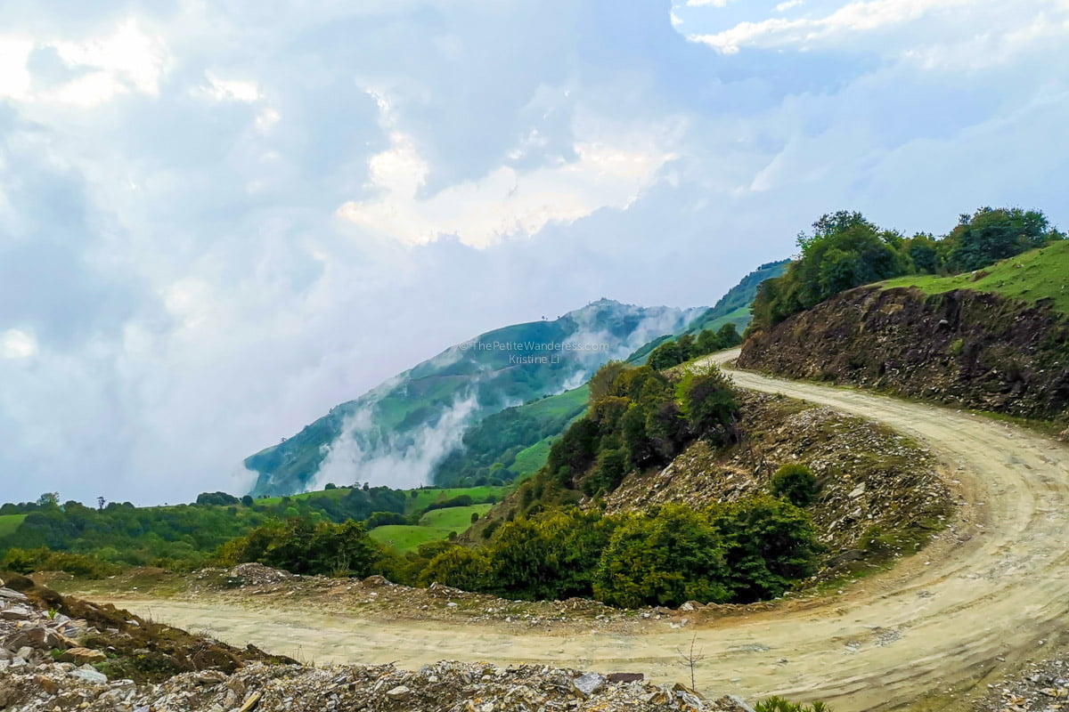 winding road down from Merak | Eastern Bhutan road trip photos • The Petite Wanderess