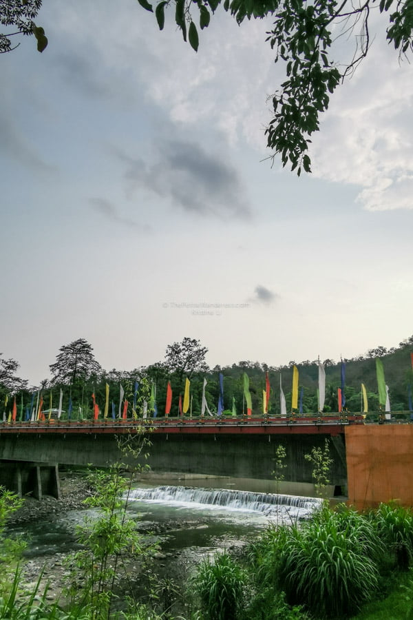 Samdrup Jongkhar colorful flags | Eastern Bhutan road trip photos • The Petite Wanderess