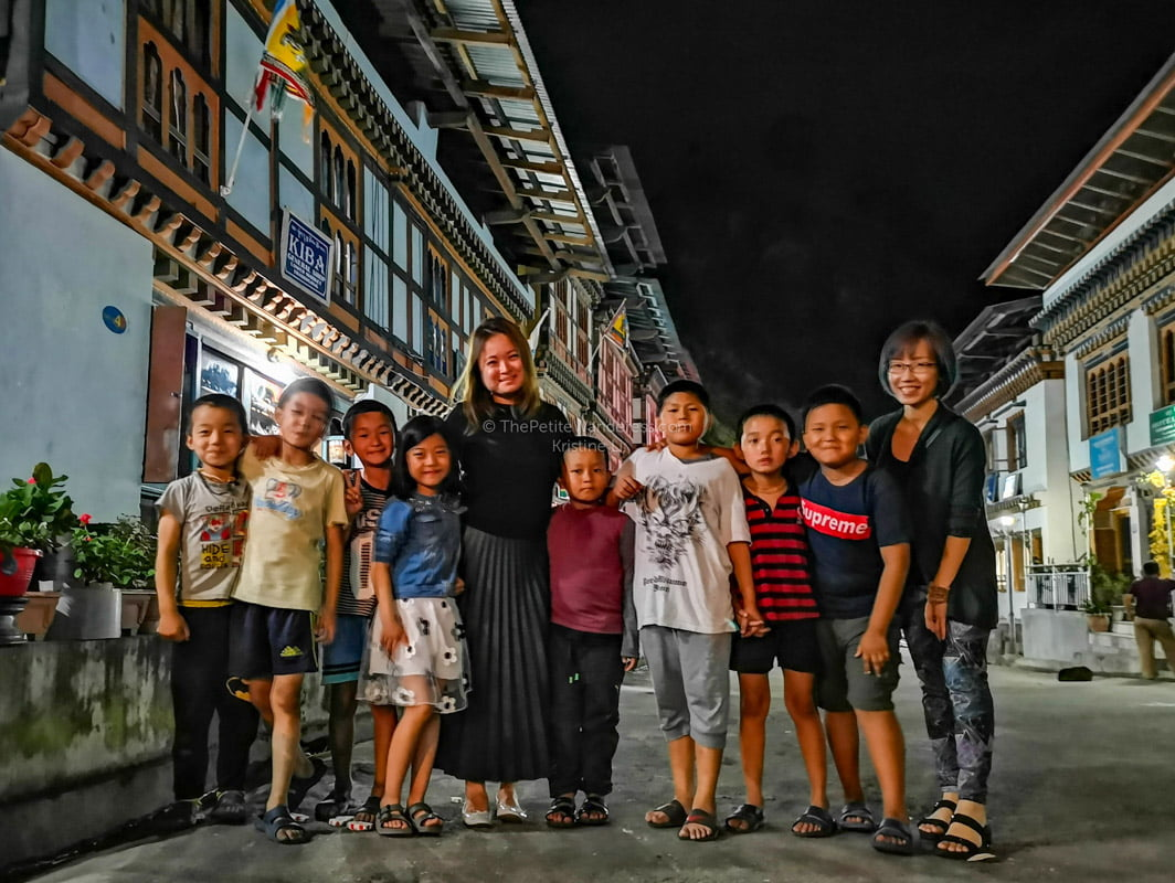 with local kids, Trashigang | Eastern Bhutan road trip photos • The Petite Wanderess