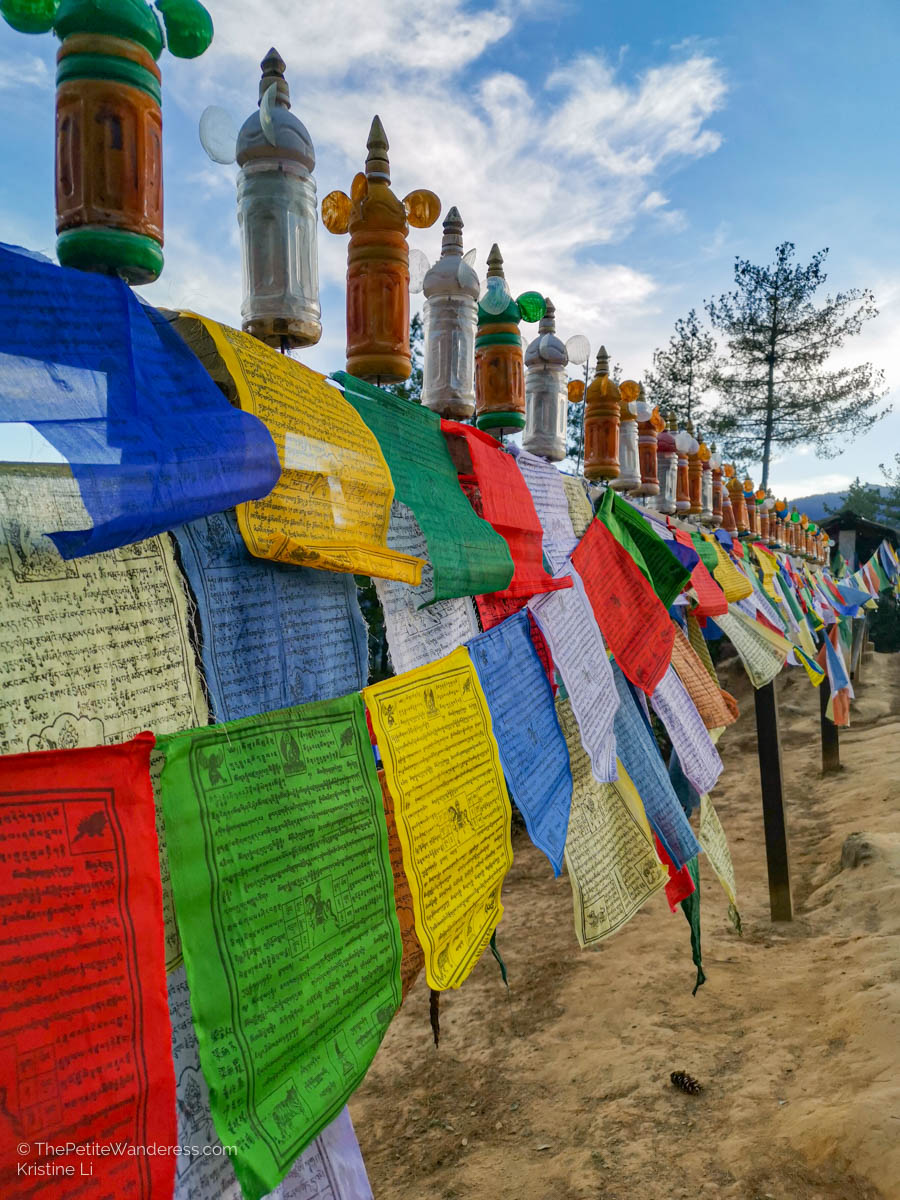 prayer flags | What Makes Neykor Meditation Trip in Bhutan Special •The Petite Wanderess