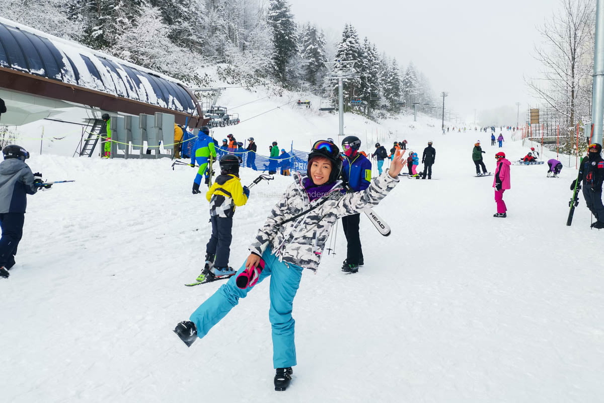 trying to pose in ski attire | What to Know for Your Niseko Ski Trip • The Petite Wanderess